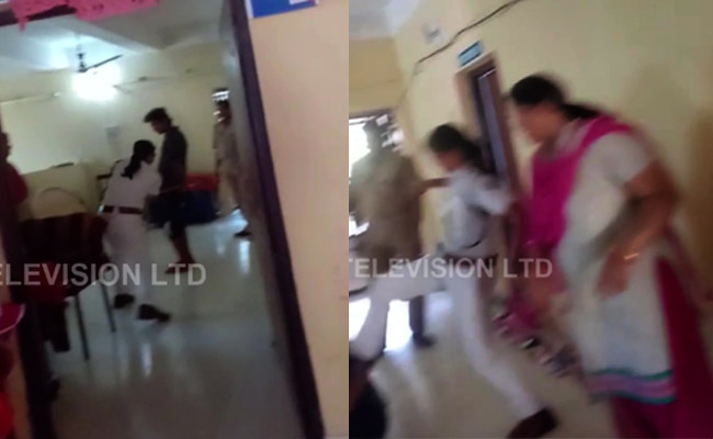 woman police thrashes youth