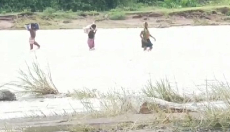 Watch: Family Risks Everything To Cross Flooded River To Save Son