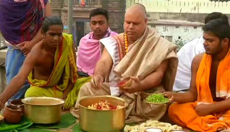 Servitors prepare Makar Chaula to be offered to Lord Jagannath and His siblings at Srimandir